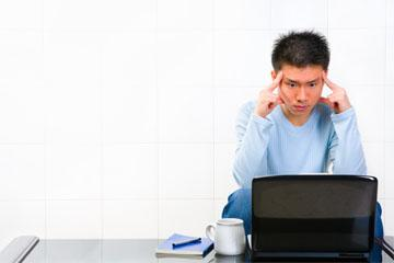 student staring at a computer
