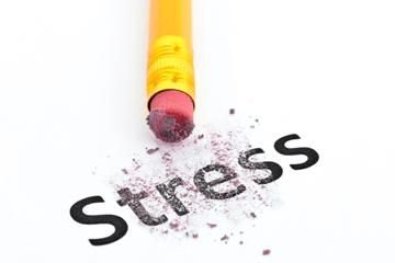 Image of the word stress being erased by a pencil