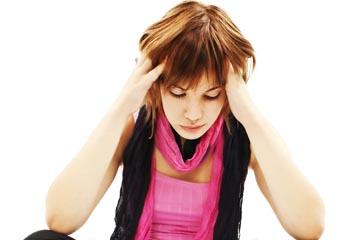 Stock photo of a woman who looks like she's stressing out