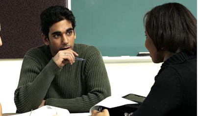 Students talking with Administrator