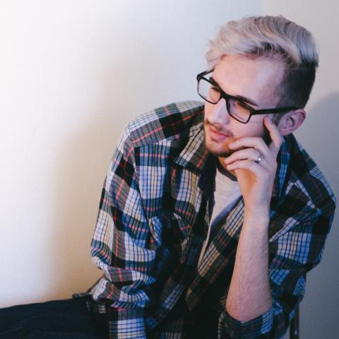 pensive man, plaid shirt, photo by Priscilla Du Preez via Unsplash