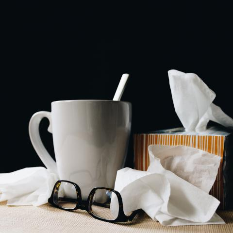 Tissues, glasses and cup with spoon