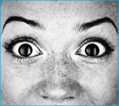 woman's face with wide-open eyes