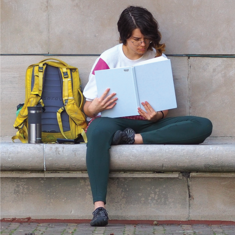 student studying on a bench
