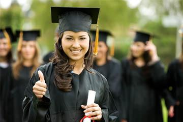 happy graduate gives thumbs-up