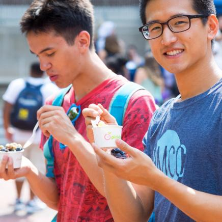 Two students eating outdoors