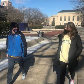 Students masked walking socially distanced